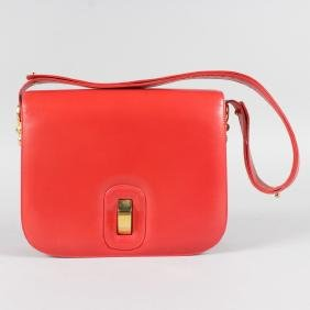 A CHINCHILLA LADIES RED LEATHER HANDBAG.