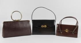 THREE BLACK LEATHER HANDBAGS.
