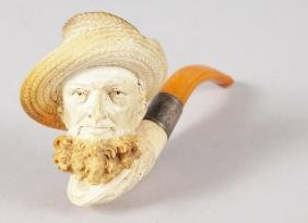 A GOOD MEERSCHAUM AND AMBER CIGARETTE PIPE, carved with