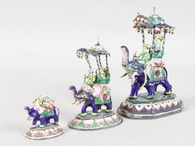 A GARNITURE OF THREE INDIAN SILVER AND ENAMEL