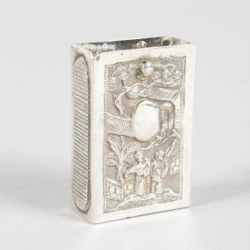 A SMALL CHINESE SILVER MATCH CASE HOLDER.