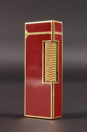 A DUNHILL RED ENAMEL GAS LIGHTER.