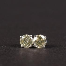 A GOOD PAIR OF 14CT WHITE GOLD 70 POINT EAR STUDS.