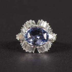A SUPERB TANZANITE AND DIAMOND RING set in platinum.