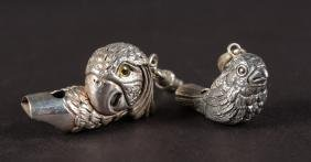 TWO NOVELTY SILVER BIRD WHISTLES.
