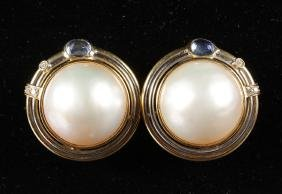 A LARGE PAIR OF PEARL EAR CLIPS set with diamonds in