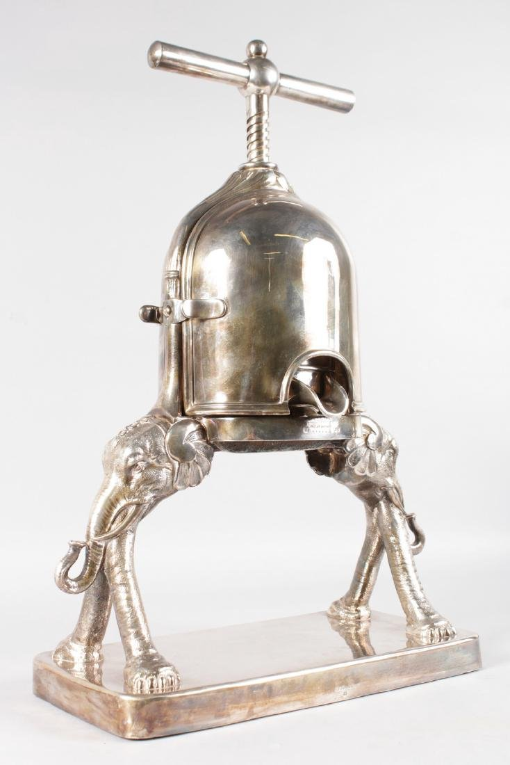 A FRENCH SILVER PLATED DUCK PRESS by CAILAR, BAYARD &