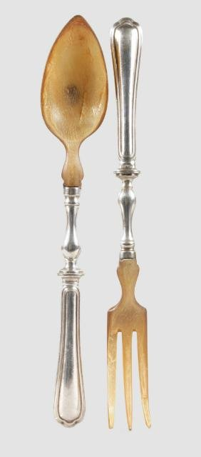 A PAIR OF SALAD SERVERS.