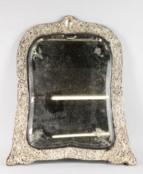 A LARGE VICTORIAN SILVER EASEL MIRROR with a good