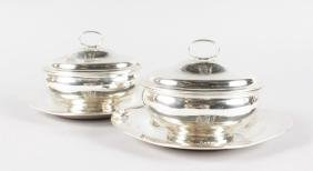 A PAIR OF GEORGE III OVAL SAUCE TUREENS, COVERS AND