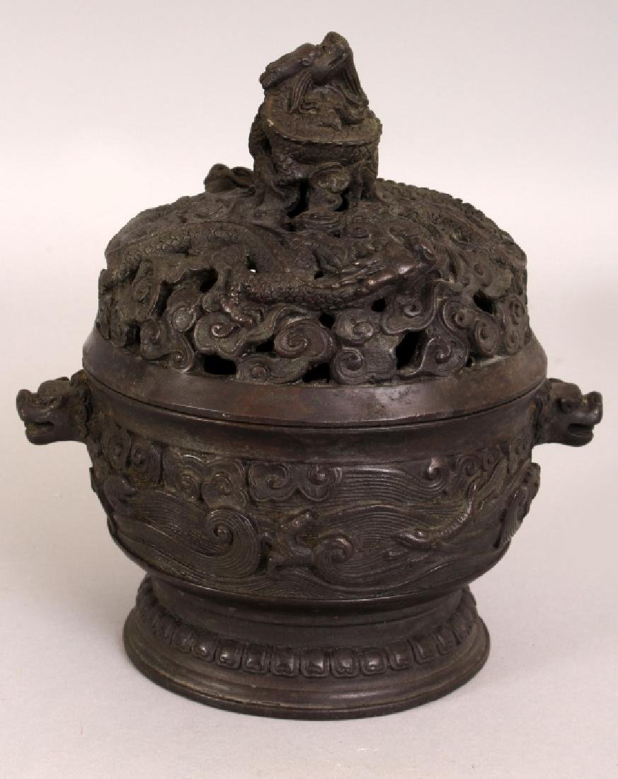 A CHINESE CIRCULAR BRONZE CENSER & COVER, weighing