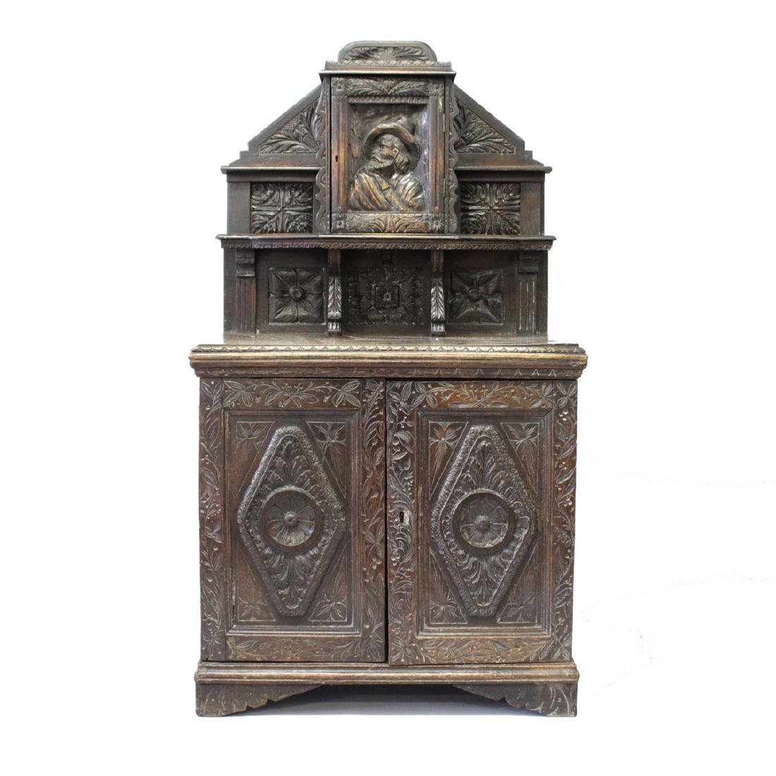 A 17TH CENTURY STYLE CARVED OAK SMALL DRESSER, 19TH