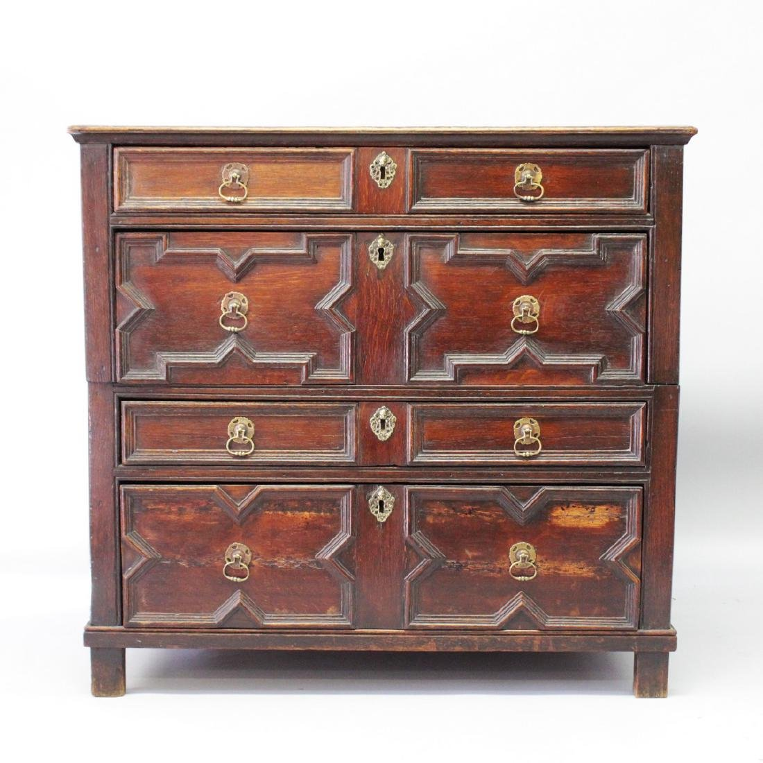 A 17TH CENTURY OAK CHEST OF DRAWERS, in two parts, with