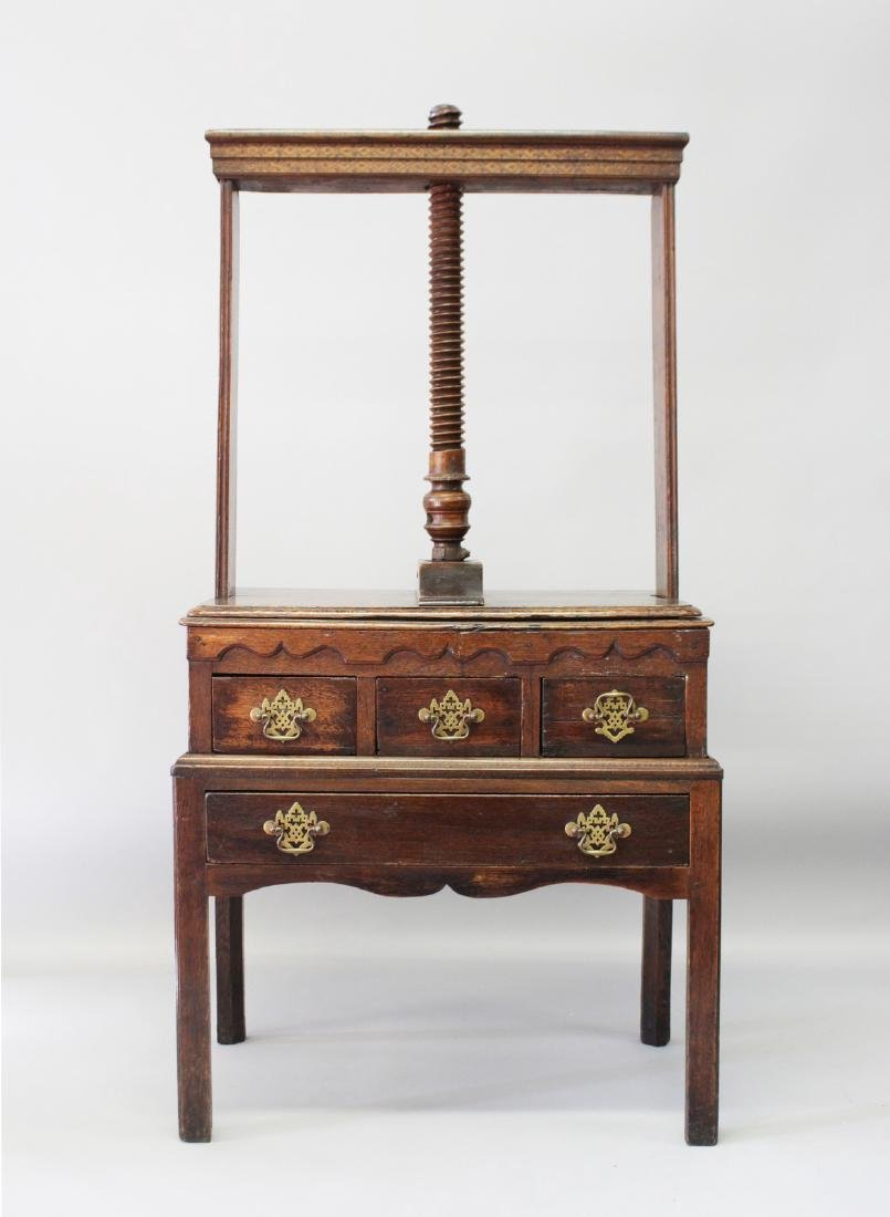 A GEORGE III OAK CLOTHES PRESS ON STAND, with screw
