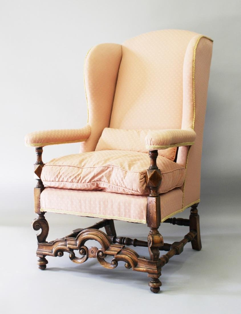 A QUEEN ANNE STYLE UPHOLSTERED WING ARMCHAIR, 20TH