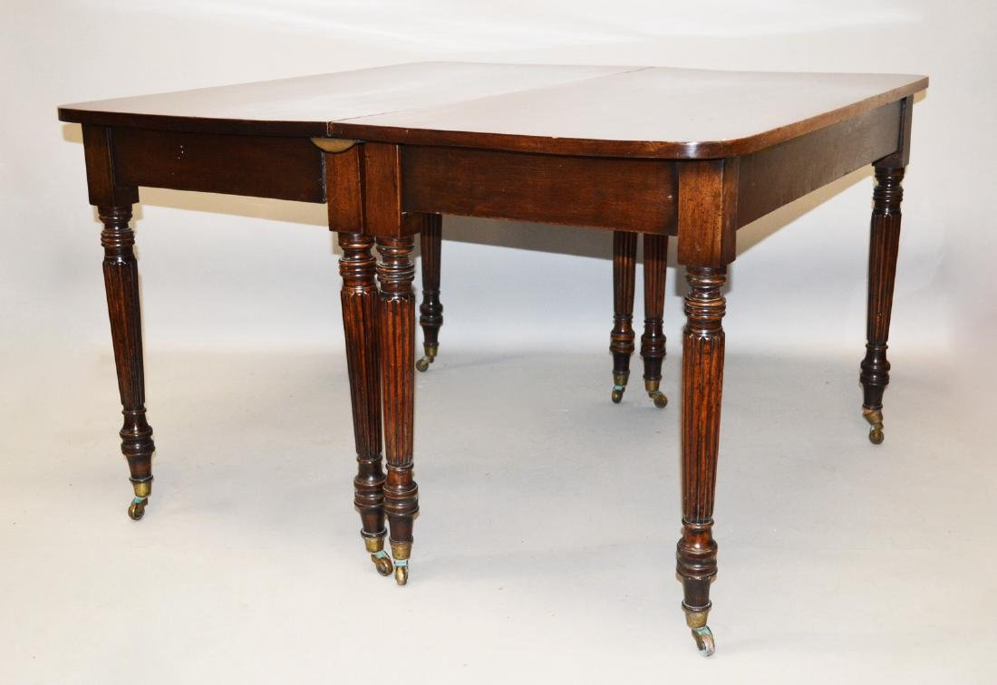 A 19TH CENTURY MAHOGANY EXTENDING DINING TABLE, In the