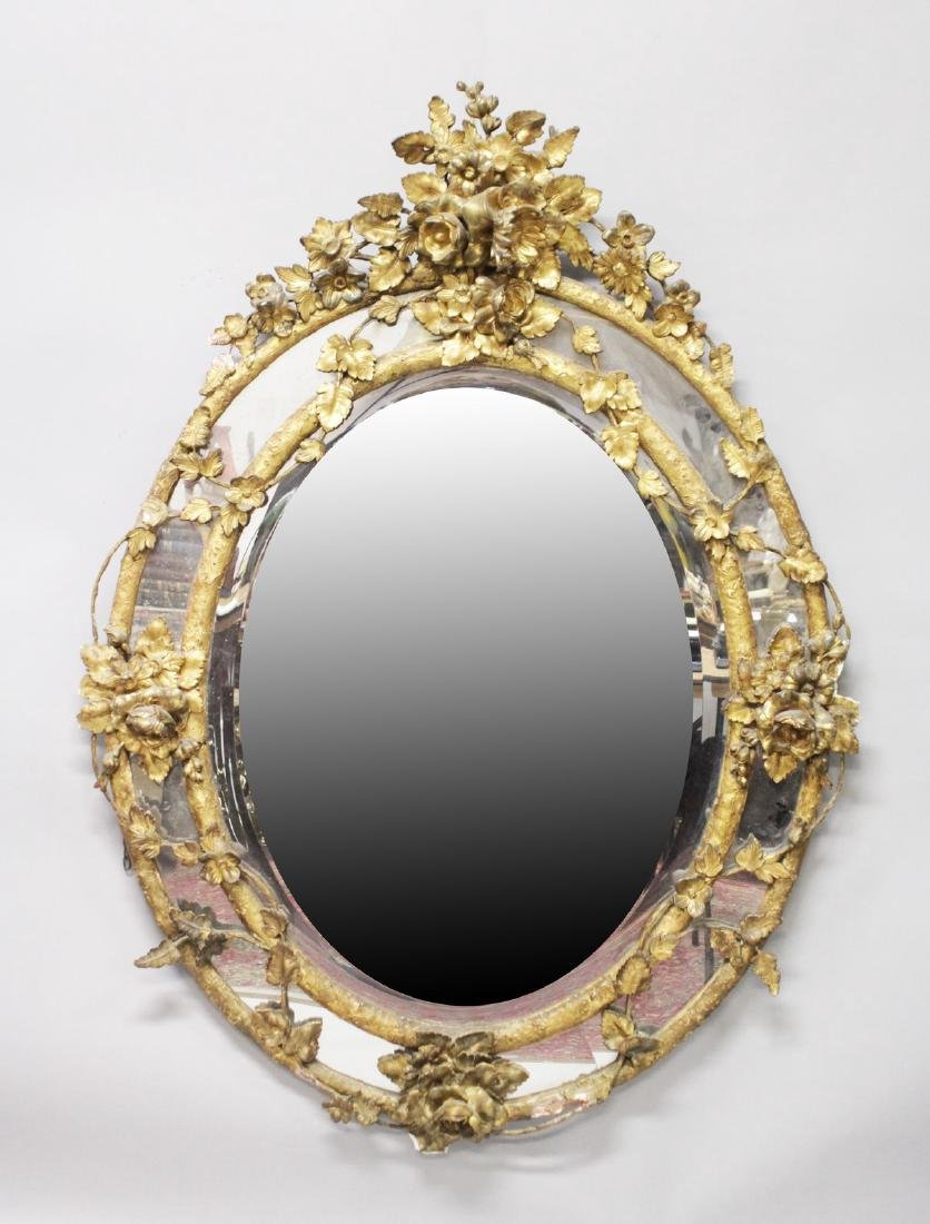 A GOOD LARGE 19TH CENTURY FRENCH OVAL GILTWOOD MIRROR