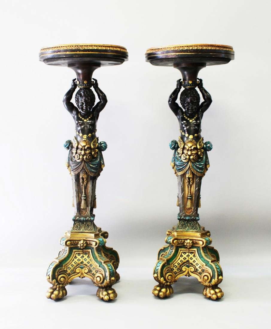 A SUPERB PAIR OF CARVED PAINTED AND GILDED BLACKAMOOR