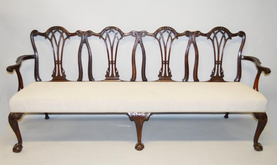 A LARGE CHIPPENDALE DESIGN MAHOGANY FOUR CHAIR BACK