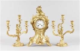 A LOUIS XVI ORMOLU THREE PIECE CLOCK GARNITURE the