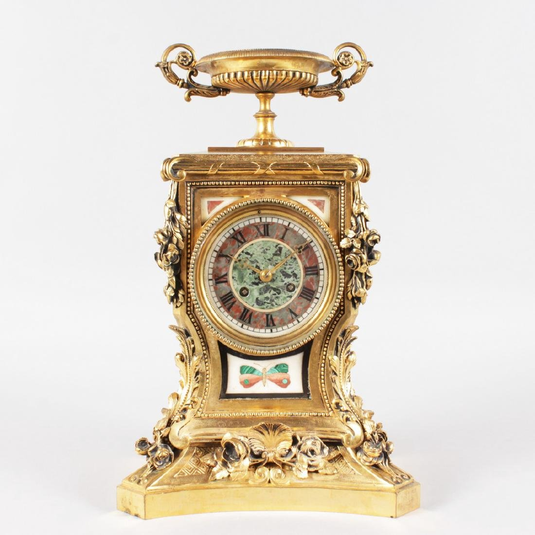 A SUPERB LOUIS XVI ORMOLU AND PIETRA DURA MANTLE CLOCK,