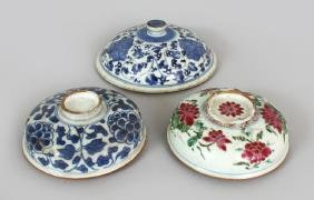 THREE 18TH CENTURY CHINESE PORCELAIN JAR COVERS, the