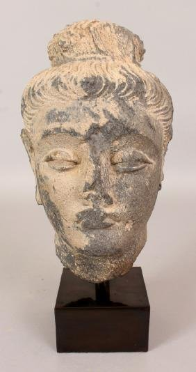 AN INDIAN GREY GANDHARA SCHIST STONE HEAD OF A