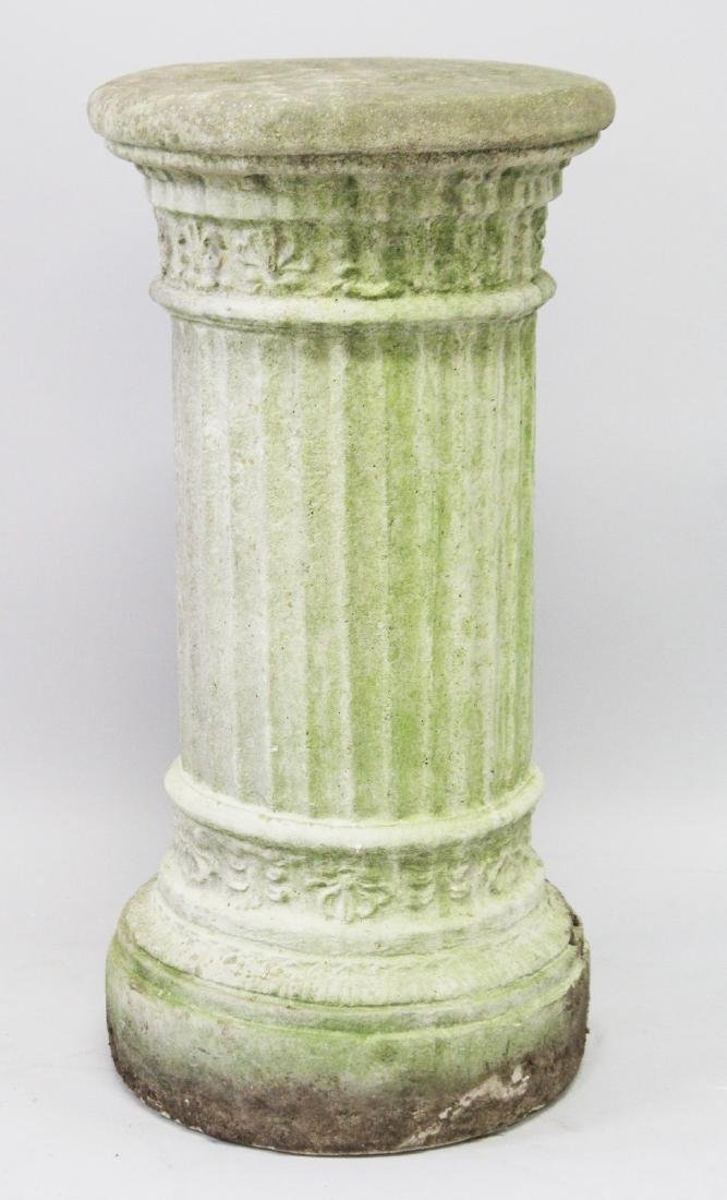 A CARVED STONE CIRCULAR PEDESTAL.  2ft 6ins high, 1ft