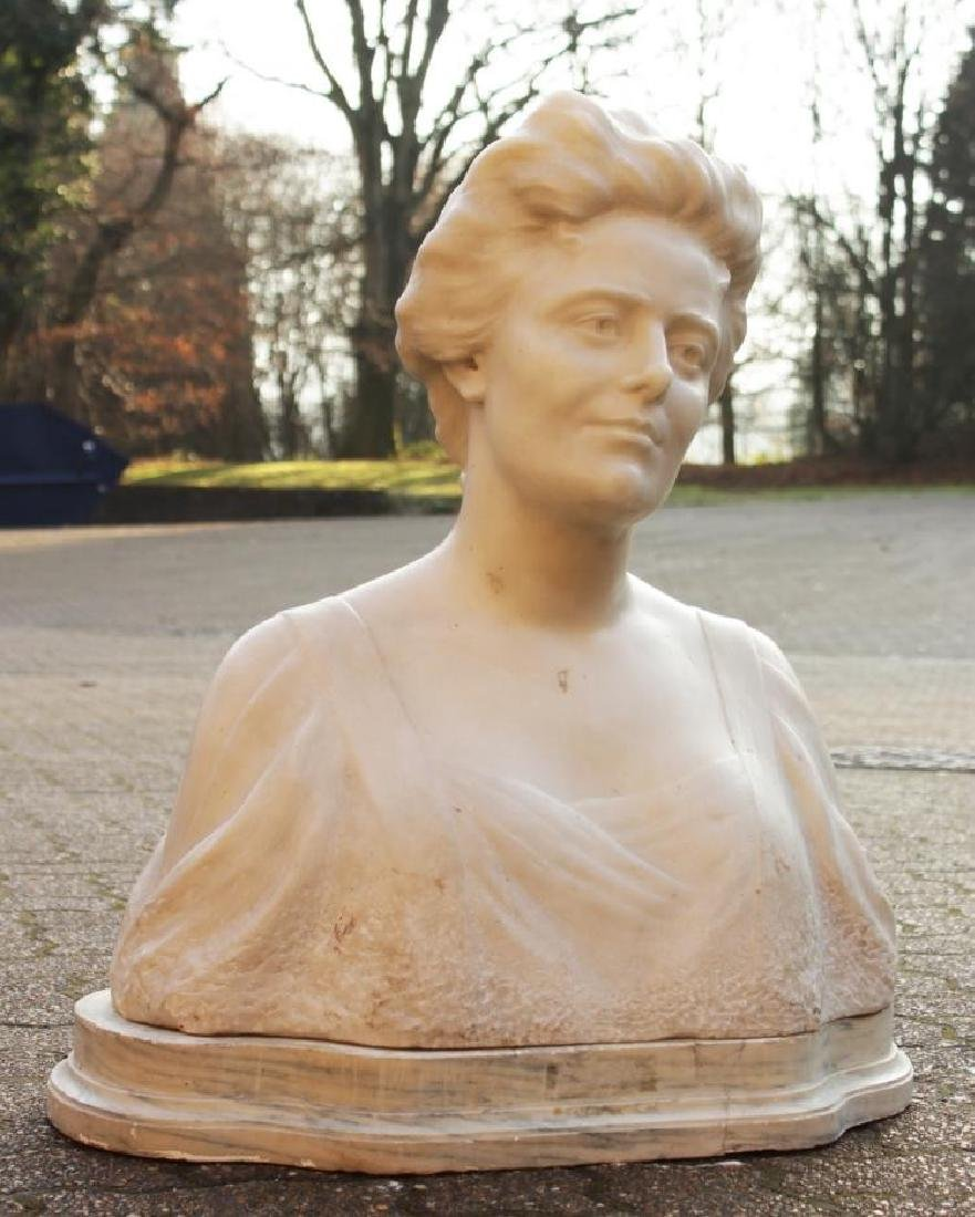 LAURE HAYMAN  A CARVED WHITE CARRARA MARBLE BUST OF