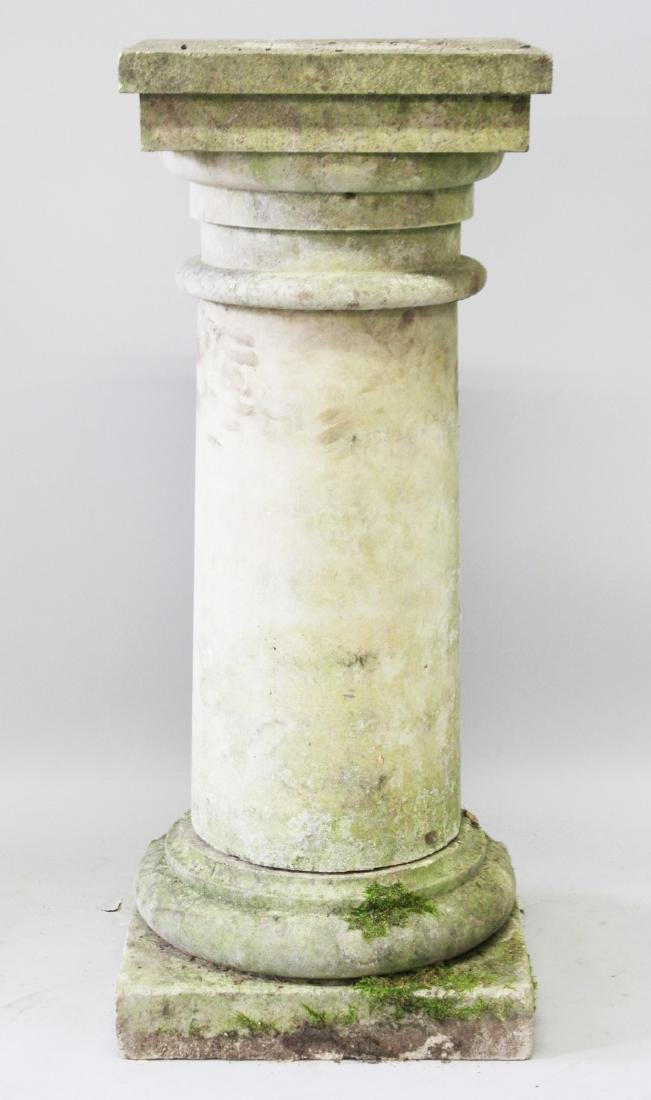 A PLAIN CIRCULAR PEDESTAL with square top and base.
