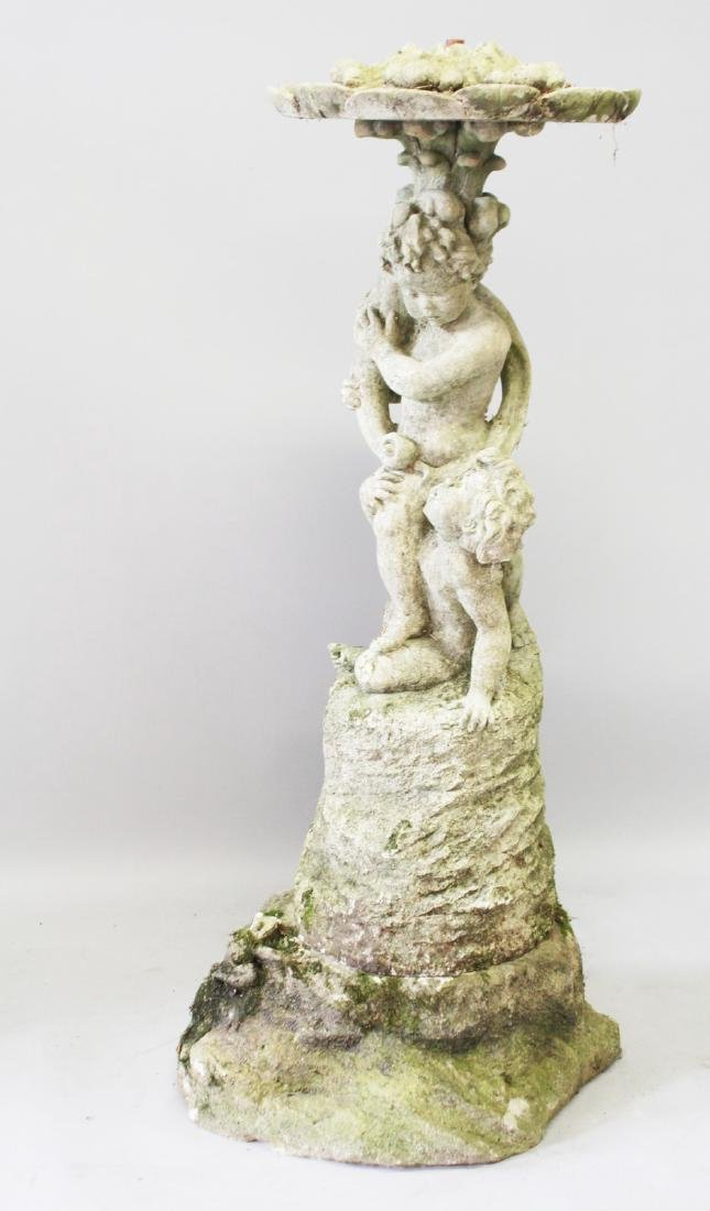 A GARDEN FOUNTAIN AND BASE, two cupids holding a