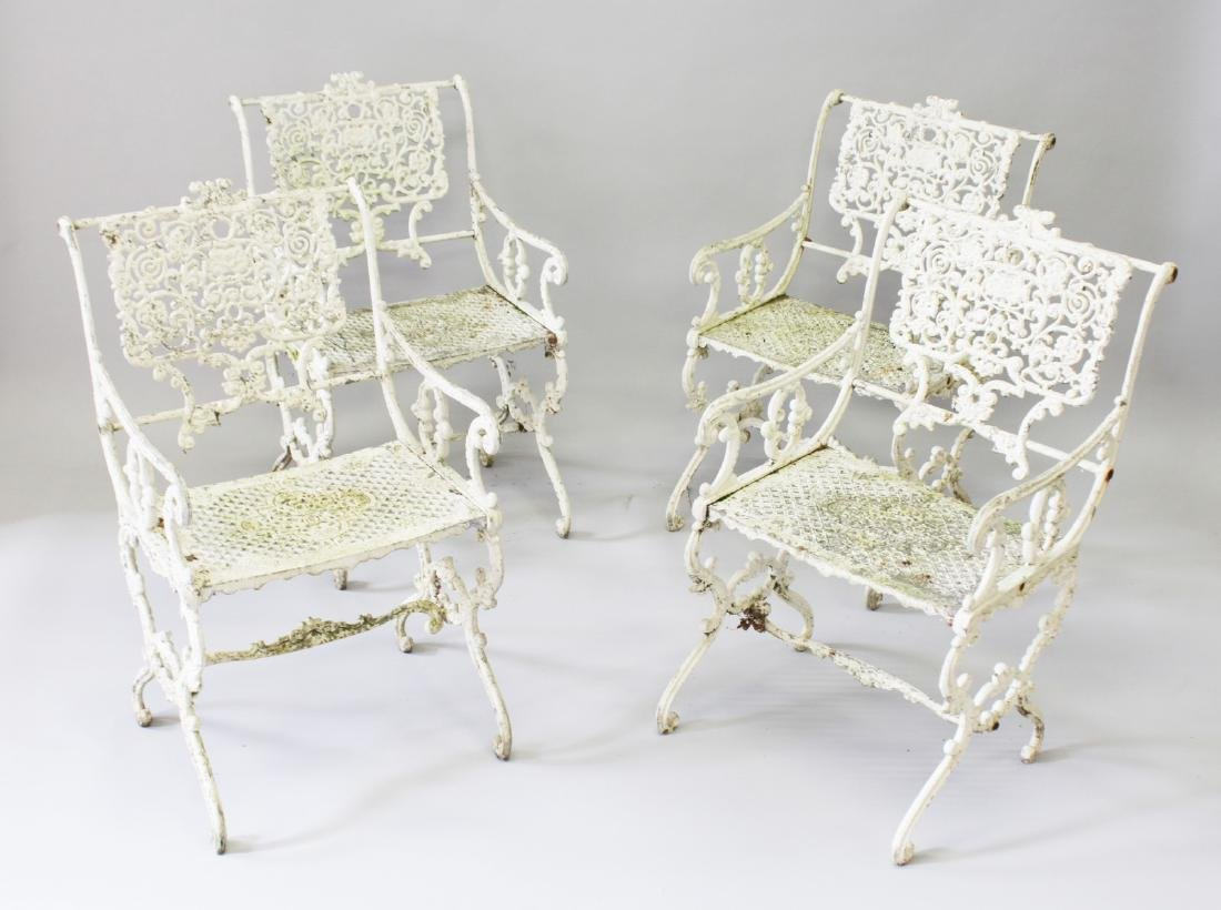 A SET OF FOUR PAINTED IRON GARDEN ARMCHAIRS.