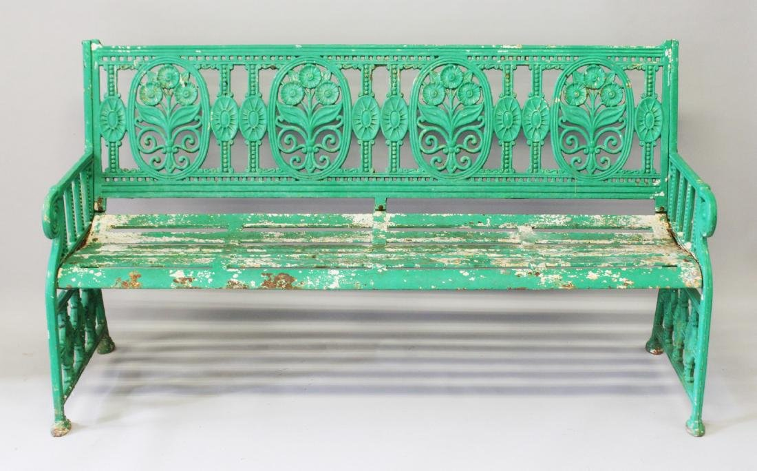 A LARGE GREEN PAINTED VICTORIAN CAST IRON GARDEN SEAT