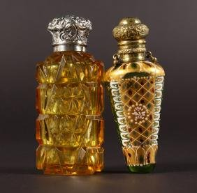 TWO VICTORIAN CUT GLASS AMBER AND ENAMEL SCENT BOTTLES