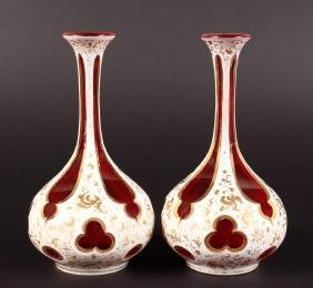 A PAIR OF BOHEMIAN PINK AND WHITE OVERLAY BOTTLE VASES