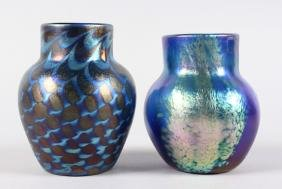 TWO SMALL LOETZ BLUE IRIDESCENT VASES.  4.25ins high.