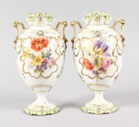 A PAIR OF CONTINENTAL EGG SHAPED TWO HANDLED VASES,