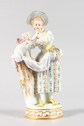 A GOOD MEISSEN FIGURE OF A SHEPHERDESS with a lamb.