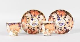 A PAIR OF ROYAL CROWN DERBY JAPAN PATTERN COFFEE CUPS