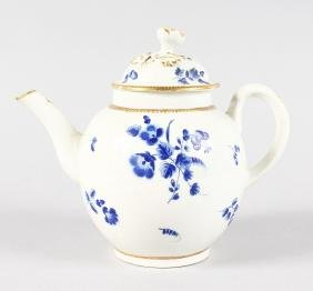 AN 18TH CENTURY WORCESTER TEAPOT AND COVER painted with
