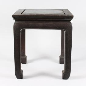 A CHINESE EBONISED HARDWOOD STAND, 20TH CENTURY, with a