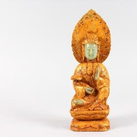 AN UNUSUAL GILDED CHINESE FIGURE OF A FEMALE DEITY,