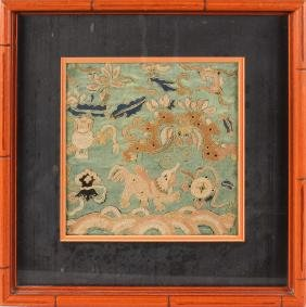 A SMALL FRAMED CHINESE NEEDLEWORK of dragons and