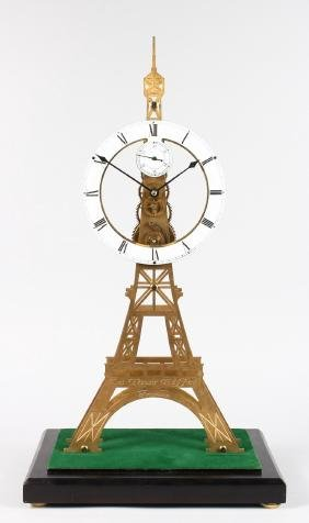 A GOOD EIFFEL TOWER BRASS SKELETON CLOCK with fusee