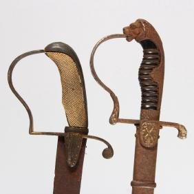 A CAVALRY OFFICERS SWORD, plain curved blade, stirrup