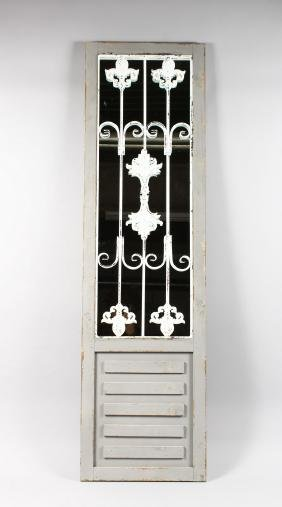 A DECORATIVE PAINTED WOOD, WROUGHT IRON AND MIRROR BACK