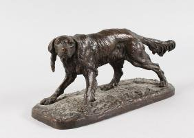 A 19TH CENTURY FRENCH BRONZED SETTER.  11ins long.