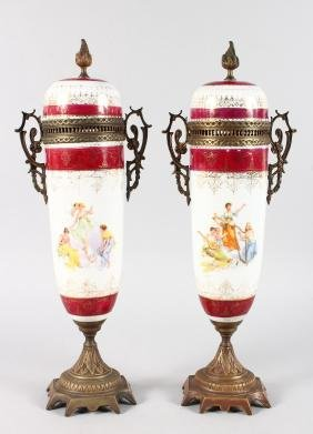 A GOOD PAIR OF FRENCH PORCELAIN METAL MOUNTED URNS AND