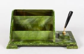 A GREEN BAKELITE TABLE DESK with pen.