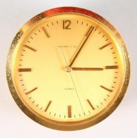 A TIFFANY & CO ROUND CLOCK.  4ins diameter.